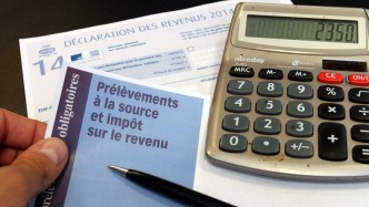 ©PHOTOPQR/L'ALSACE ; Un formulaire de déclaration d'impots sur le revenu et de prélèvement à la source à Mulhouse le 20 Mai 2015 (MaxPPP TagID: maxnewsworldthree756630.jpg) [Photo via MaxPPP]