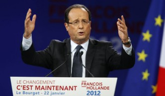 861441_francois-hollande-socialist-party-candidate-for-the-2012-french-presidential-election-delivers-a-speech-as-he-attends-a-political-rally-in-le-bourget1